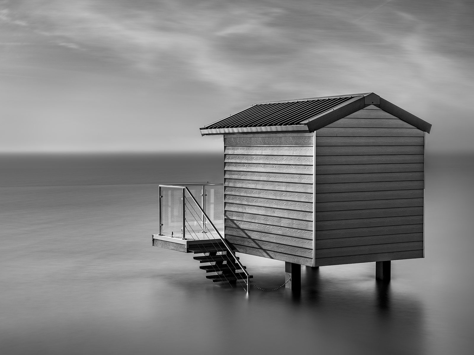 <h5>Beach Huts at Hight Water </h5><p>Monochrome print by Sophia Spurgin																	</p>