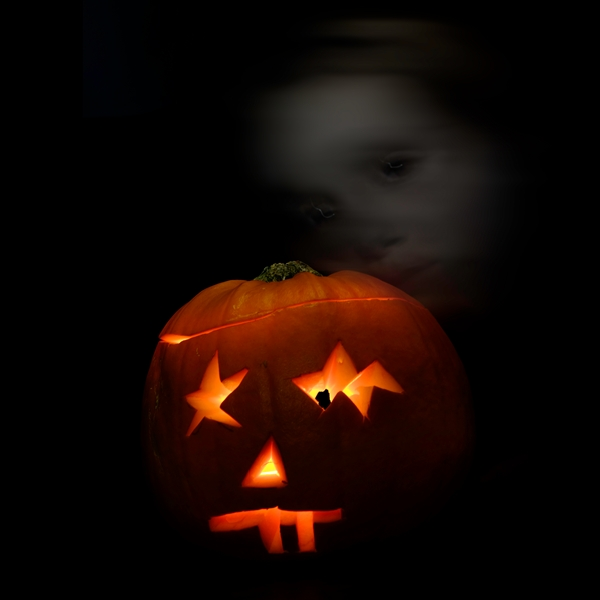 Pumpkin with shadowy young girl behind